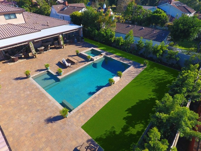 Artificial Grass Adds Entirely New Dimension to Hillside Pavers' Landscaping Projects